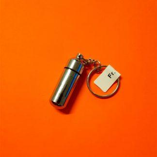 kleiner Schlüsselanhänger mit Kapsel kaufen